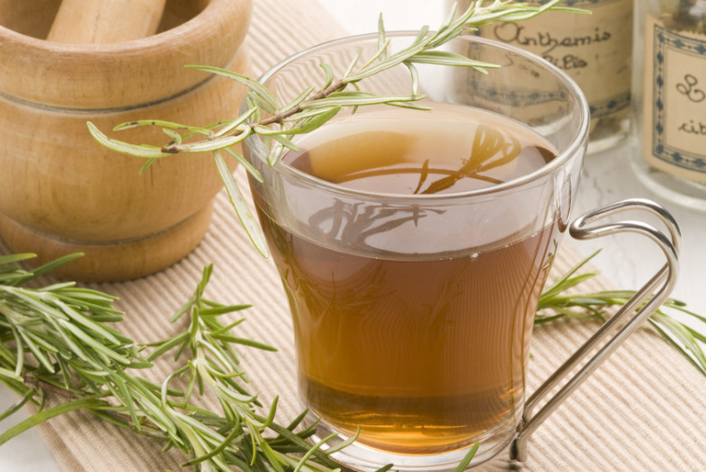 Herbal tea.Rosemary infusion in a glass cup.Rosmarinus officinalis.Naturopathy.Selective focus.