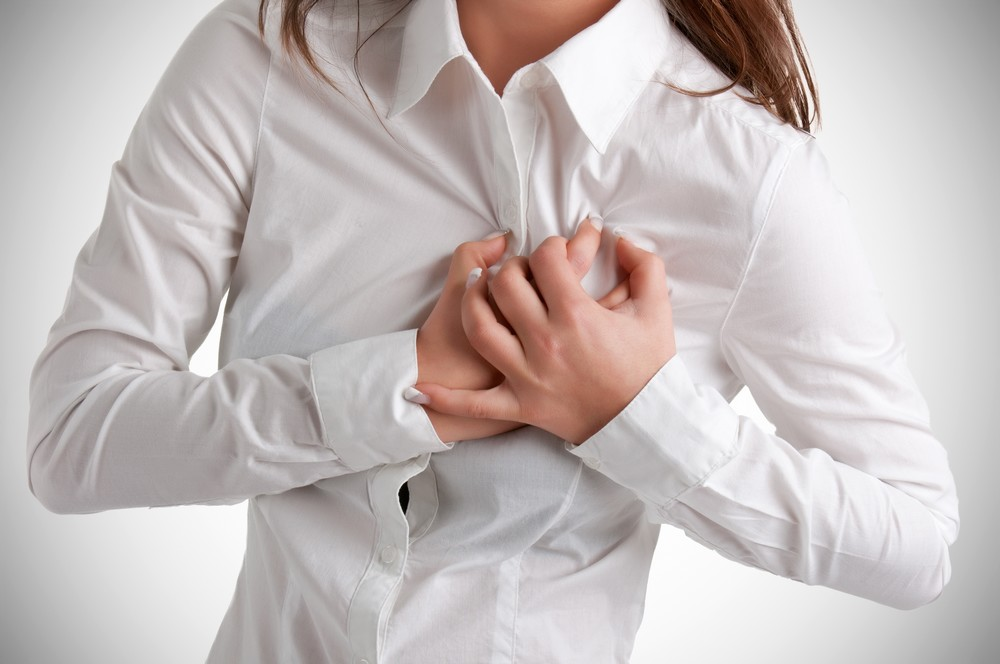 Woman having a pain in the heart area